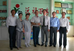Gary Young and Sue Chao meeting with officials from the Ningxia Red wolfberry facility