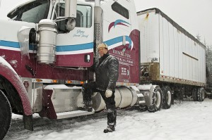 Gary Young standing next to semi truck in the snow