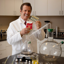 Gary Young displaying Essentialzyme product