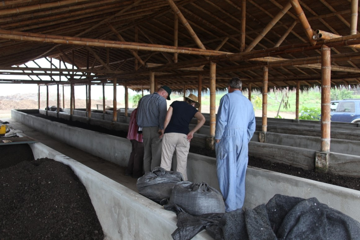 Visitors are viewing one of Young Living's six large worm houses in Ecuador.