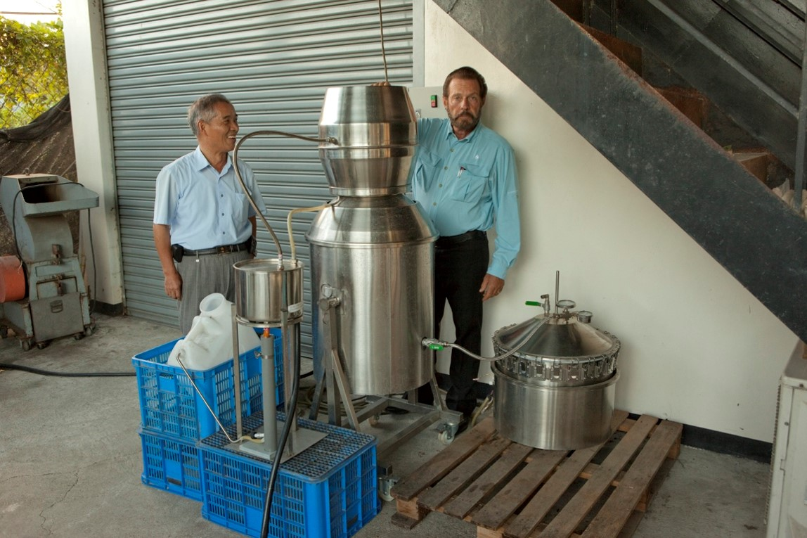 This is Young Living's distilling project located in Taiwan. Gary and Dr. Li are standing by the first distiller that was installed in September of 2012. A second distiller was installed there in April of 2013.