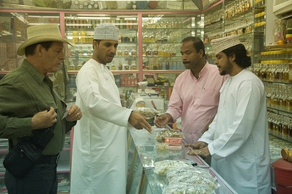 Choosing frankincense samples from a Salalah, Oman, shop to take back to the laboratory for testing.