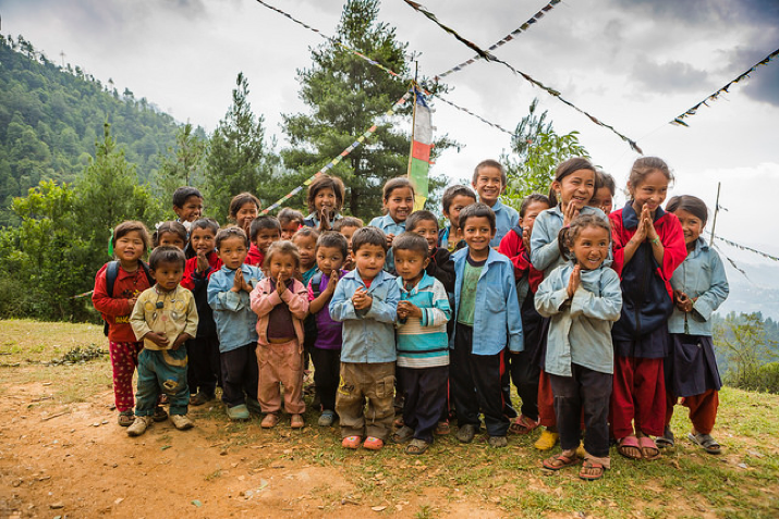 "The beautiful children of Yarsa, Nepal, show the traditional Hindu greeting ""Namaste,"" which means, ""I bow to the divine in you."""